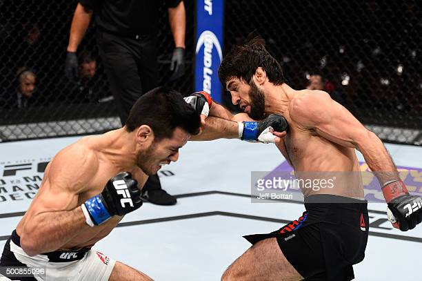 Phillipe Nover and Zubaira Tukhugov exchange punches in their featherweight bout during the UFC Fight Night event at The Chelsea at the Cosmopolitan...