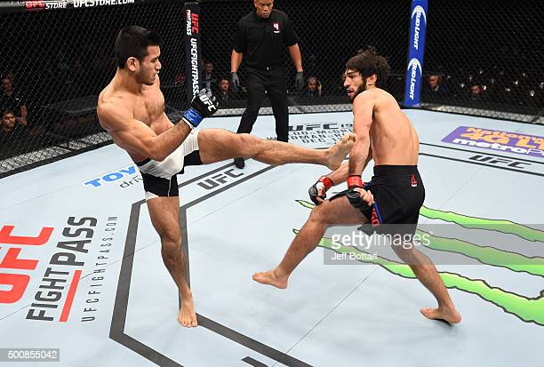 Phillipe Nover kicks Zubaira Tukhugov in their featherweight bout during the UFC Fight Night event at The Chelsea at the Cosmopolitan of Las Vegas on...