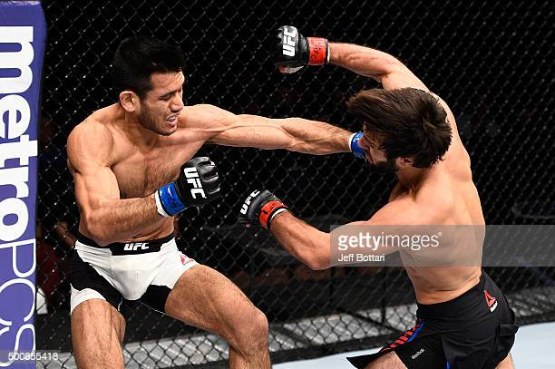 Phillipe Nover punches Zubaira Tukhugov in their featherweight bout during the UFC Fight Night event at The Chelsea at the Cosmopolitan of Las Vegas...
