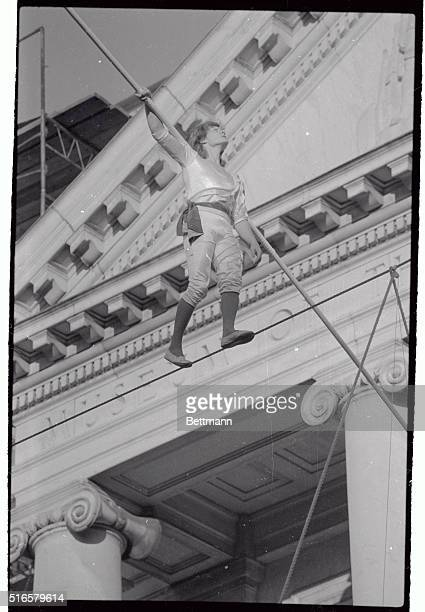 Phillipe Petit the celebrated French high wire artist is shown here as he walks the high wire connecting the north and south wings of the Museum of...