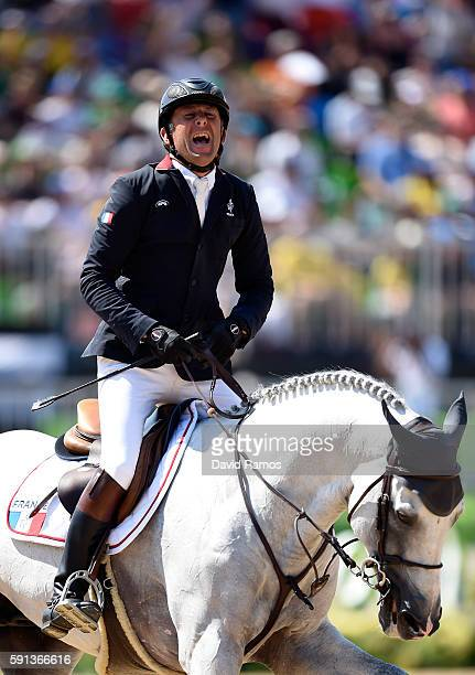 Phillipe Rozier of France reacts after riding Rahotep De Toscane during the Jumping Team Round 2 during Day 12 of the Rio 2016 Olympic Games at the...