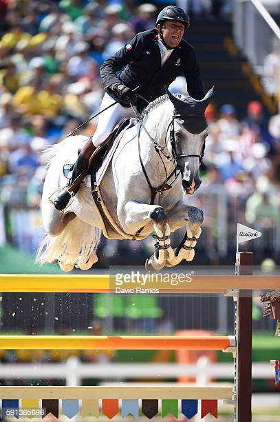 Phillipe Rozier of France rides Rahotep De Toscane during the Jumping Team Round 2 during Day 12 of the Rio 2016 Olympic Games at the Olympic...