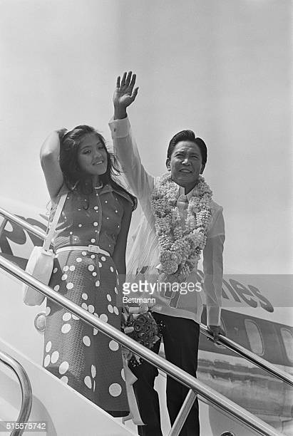 Phillipine President Ferdinand E Marcos and daughter Imee wave to crowd before boarding a plane for Peking 6/7 President Marcos and First Lady Imelda...