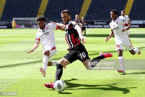 Phillipp Mwene of 1. FSV Mainz 05 tries to block the shot of Filip Kostic of Eintracht Frankfurt during the Bundesliga match between Eintracht...
