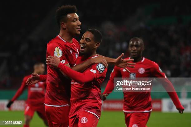Phillipp Mwene of FSV Mainz celebrates scoring his teams first goal of the game with team mates Anthony Ujah and Karim Onisiwo during the DFB Cup...