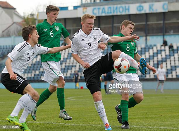 Phillipp Ochs of Germany competes for the ball with Georgie Poynton and Adam Mc Donnel of Ireland during the UEFA Under17 Elite Round between Germany...