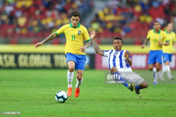 Phillippe Coutinho of Brazil battles for the ball against Luis Garrido of Honduras during the match Brazil v Honduras at BeiraRio Stadium on June 9...