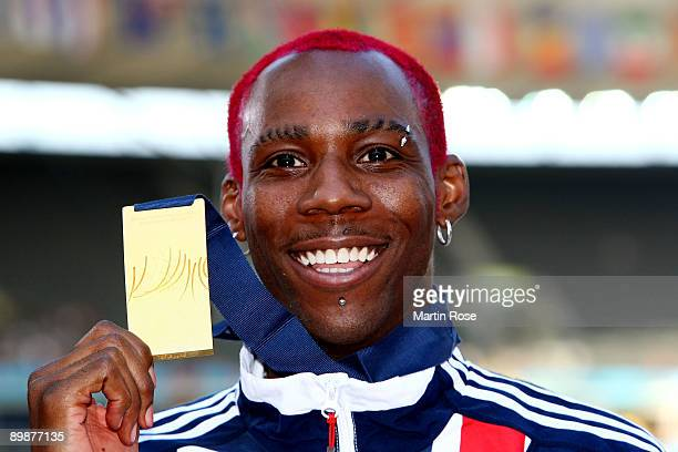 Phillips Idowu of Great Britain Northern Ireland receives the gold medal during the medal ceremony for the men's Triple Jump Final during day five of...