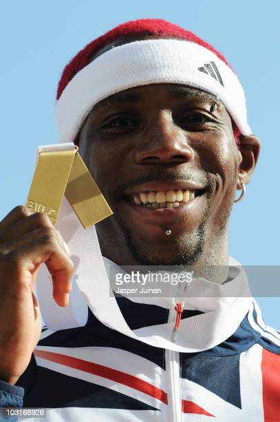 Phillips Idowu of Great Britain receives the gold medal in the Mens Triple Jump during day four of the 20th European Athletics Championships at the...