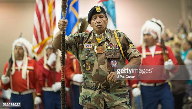 Phillp Coon a Creek/Seminole Vietnam Veteran leads the grand entry at the Red Earth Native American Festival Friday June 10 2016 in Oklahoma City