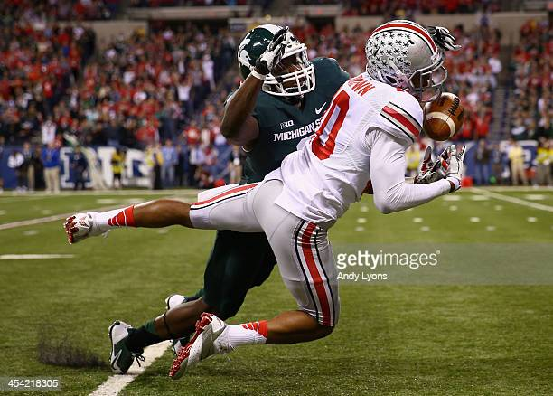 Philly Brown of the Ohio State Buckeyes cannot make the catch over the defense of Isaiah Lewis of the Michigan State Spartans during the Big Ten...