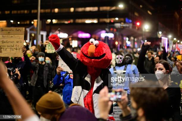 Philly Elmo participates in a combined protest march as two separate groups of demonstrators take to the streets in unison, in Philadelphia, PA, USA...