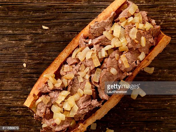 philly steak sandwich with onions - submarine sandwich stock pictures, royalty-free photos & images
