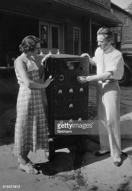 Philo T Fransworth 28yearold inventor and scientist explaining to his wife the intricate details of the television apparatus on which he has worked...