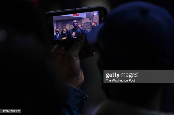 Philonise Floyd, brother of George Floyd is recorded on a mobile phone as he speaks during a news conference before a prayer vigil at Greater...