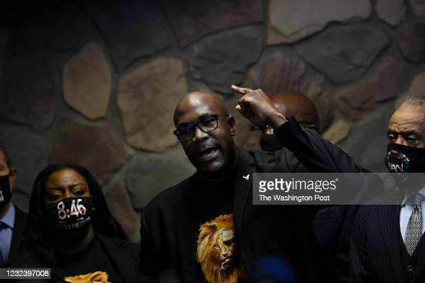 Philonise Floyd, brother of George Floyd is surround by family members, Reverend Al Sharpton and Attorney Benjamin Crump as he speaks during a news...