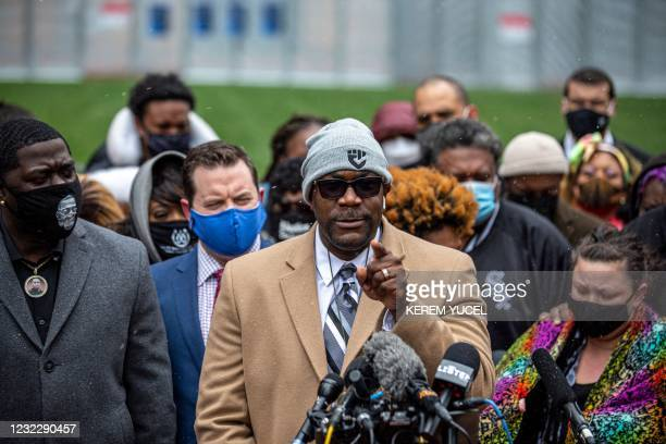 Philonise Floyd , brother of George Floyd speaks as Brandon Williams , nephew of George Floyd and Katie Wright, mother of Daunte Wright listen during...