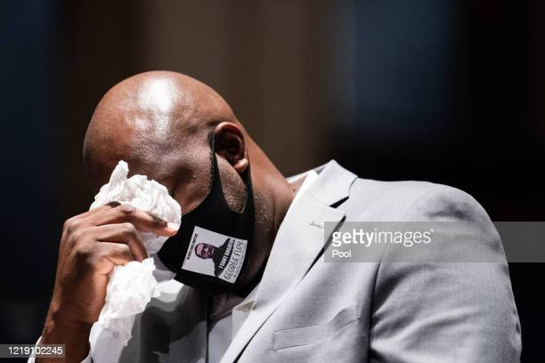 Philonise Floyd brother of George Floyd tears up while testifying during a House Judiciary Committee at a hearing on police accountability on Capitol...