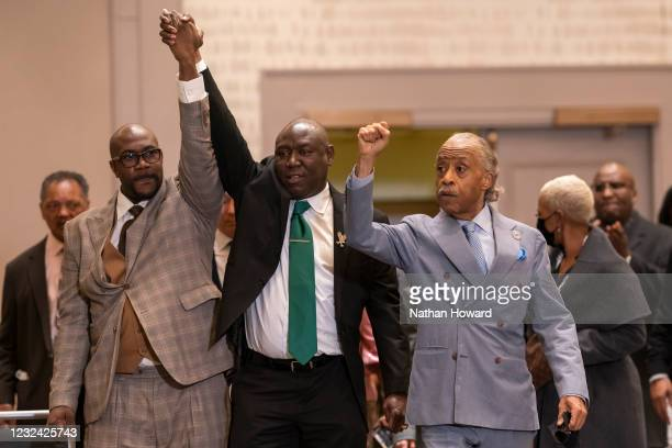 Philonise Floyd, Floyd family attorney Ben Crump and the Rev. Al Sharpton raise their fists following today's verdict in the trial of Derek Chauvin...
