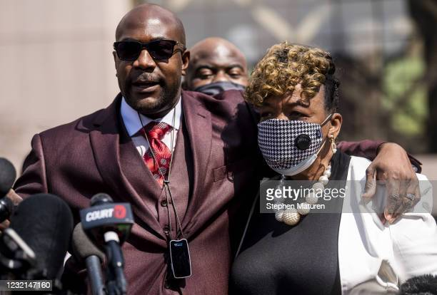 Philonise Floyd, George Floyd's brother, embraces Gwen Carr as he speaks outside the Hennepin County Government Center on April 6, 2021 in...