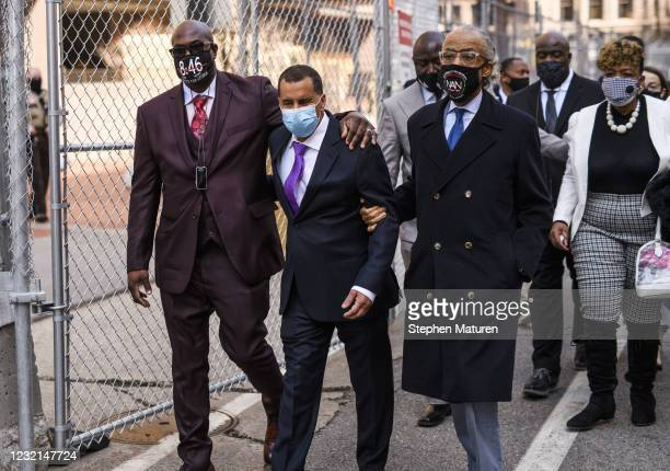 Philonise Floyd , George Floyd's brother, former New York Governor David Patterson , and Rev. Al Sharpton walk outside the Hennepin County Government...