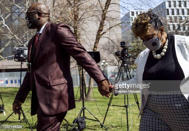 Philonise Floyd, George Floyd's brother, holds hands with Gwen Carr as they arrive for a press conference outside the Hennepin County Government...