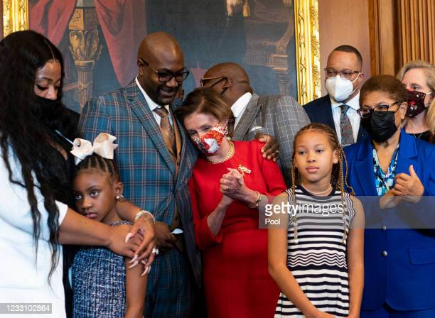 Philonise Floyd, George Floyd's brother, hugs Speaker of the House Nancy Pelosi prior to a meeting to mark the one anniversary of his death, May 25,...