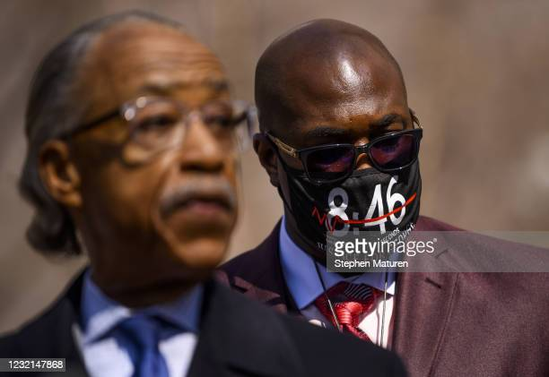 Philonise Floyd , George Floyd's brother, listens as Rev. Al Sharpton speaks outside the Hennepin County Government Center on April 6, 2021 in...