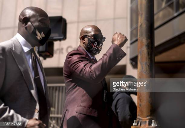 Philonise Floyd, George Floyd's brother, raises his fist as he enters the Hennepin County Government Center joined by attorney Ben Crump on April 6,...