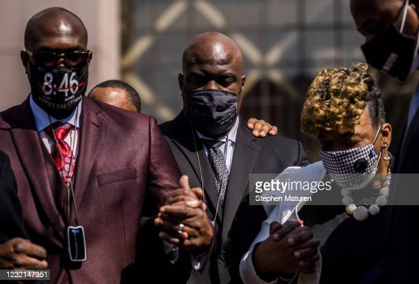 Philonise Floyd , Rodney Floyd, both brothers of George Floyd, Gwen Carr, and Ray McGuire hold hands and bow their heads as Rev. Al Sharpton leads a...