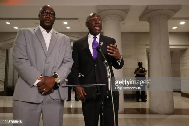 Philonise Floyd the brother of George Floyd and his lawyer Benjamin Crump make brief statements during a break in a House Judiciary Committee hearing...