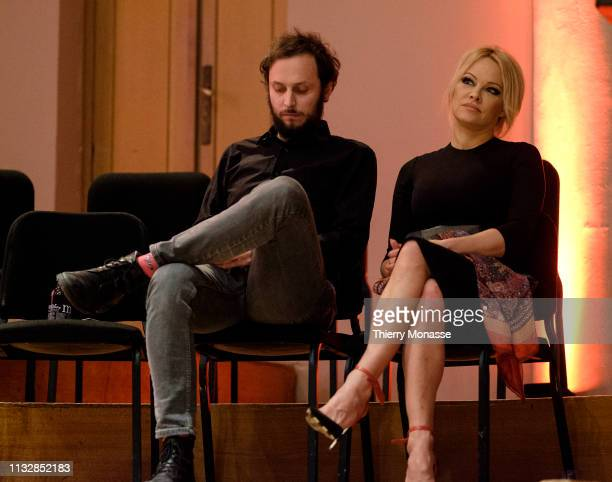 Philosopher author and political activist Srecko Horvat and the activist for the animal rights movement Pamela Anderson are listening during the...