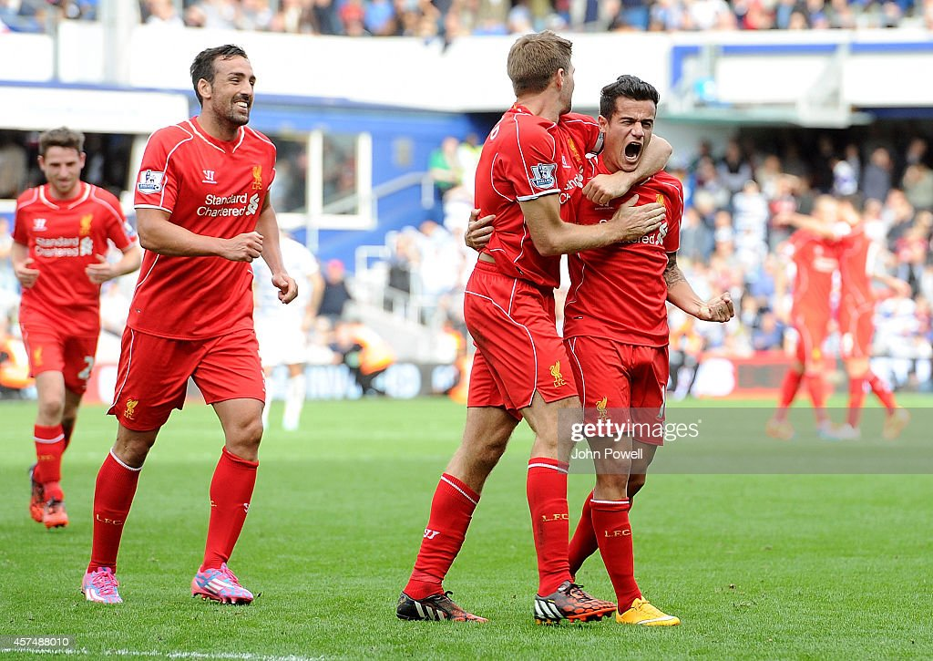Philppe Coutinho of Liverpool scores their second goal during the Barclays Premier League match between Queens Park Rangers and Liverpool at Loftus Road on October 19, 2014 in London, England.