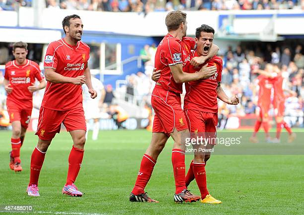Philppe Coutinho of Liverpool scores their second goal during the Barclays Premier League match between Queens Park Rangers and Liverpool at Loftus...
