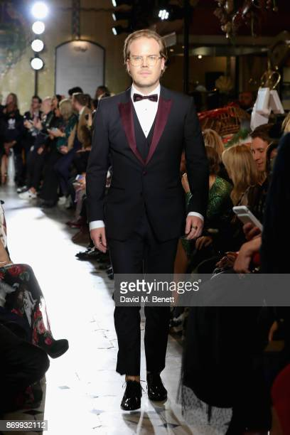 Phineas Page walks the Dolce Gabbana Italian Christmas catwalk show at Harrods on November 2 2017 in London England