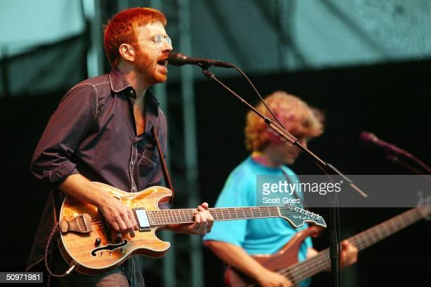 Phish lead singer Trey Anastasio on left and bassist Mike Gordon perform on stage at Keyspan Park on Coney Island June 17 2004 in Brooklyn New York