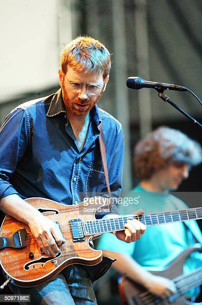 Phish lead singer Trey Anastasio, on left, and bassist Mike Gordon perform on stage at Keyspan Park on Coney Island June 17, 2004 in Brooklyn, New...