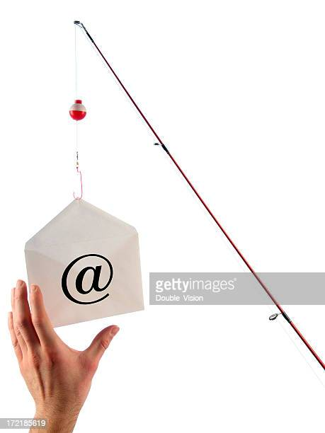 phishing concept: fishing pole dangles email and hand takes bait - temptation stock pictures, royalty-free photos & images