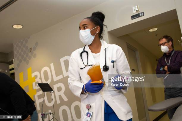 Phlebotomist Jenee Wilson carries COVID19 convalescent plasma from a donor at Bloodworks Northwest on April 17 2020 in Seattle Washington The plasma...