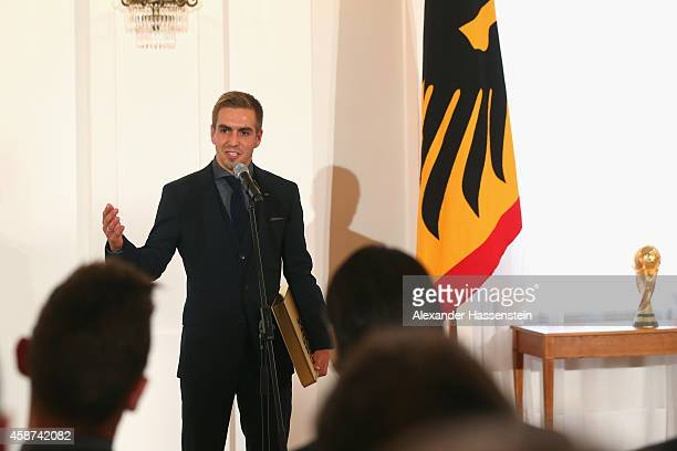 Phlipp Lahm, team captain of the German national football team speaks during the Silbernes Lorbeerblatt Award Ceremony at Schloss Bellevue Palace on...