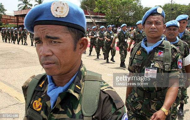 Cambodian peacekeepers march in formation before leaving Phnom Penh for Sudan at the Royal Cambodia Air Force base in the capital, 15 April 2006....