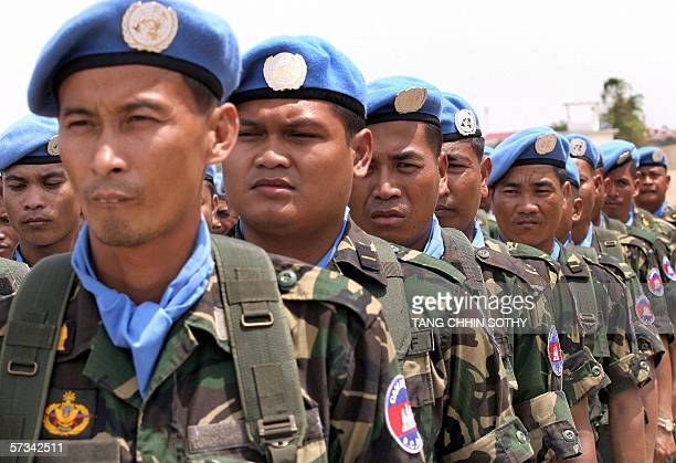 Cambodian peacekeepers stand in formation before leaving Phnom Penh for Sudan at the Royal Cambodia Air Force base in the capital, 15 April 2006....