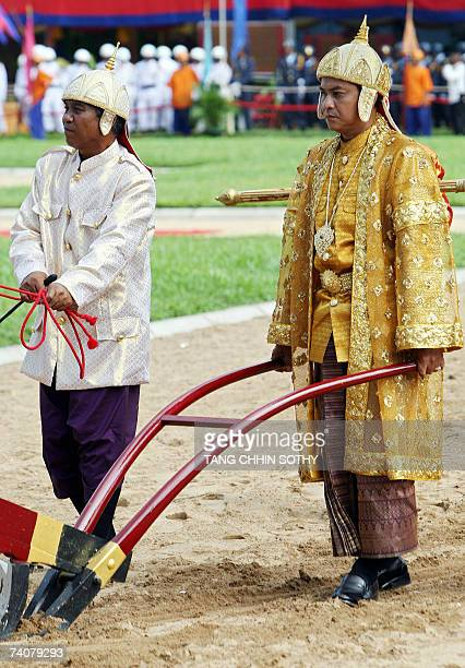 Cambodian prince Norodom Sengharath plows during the annual Royal Plowing ceremony in Phnom Penh 05 May 2007 Cambodia's royal cows signalled a...