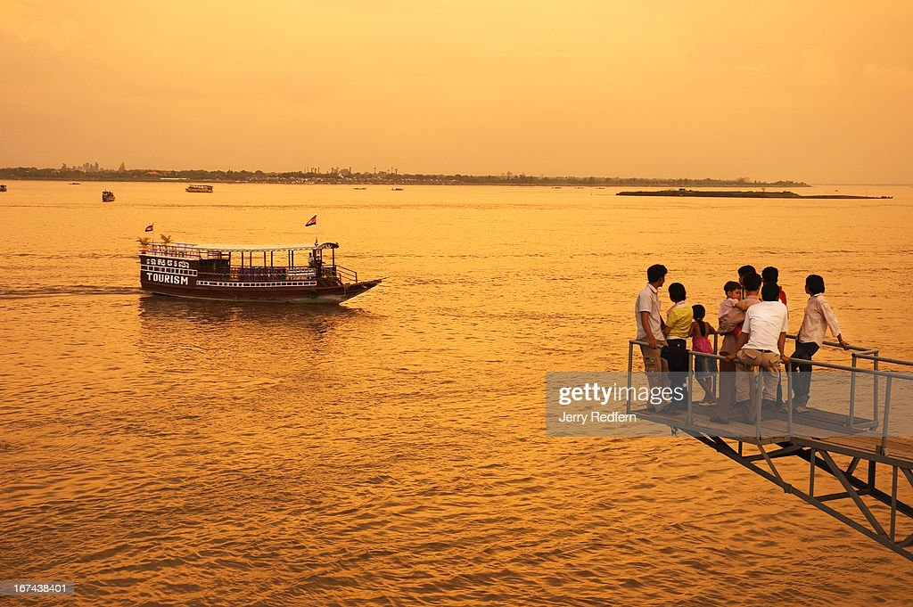 Phnom Phenois take in the evening along the Tonle Sap river, watching the river and tour boats roll by..