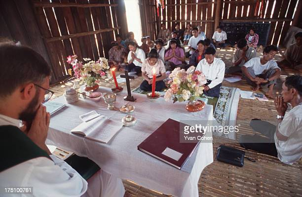 BOUSRA MONDOLKIRI CAMBODIA Phnong montagnard people in northeastern Cambodia celebrate a catholic mass in a bamboo church The mass is being led by...