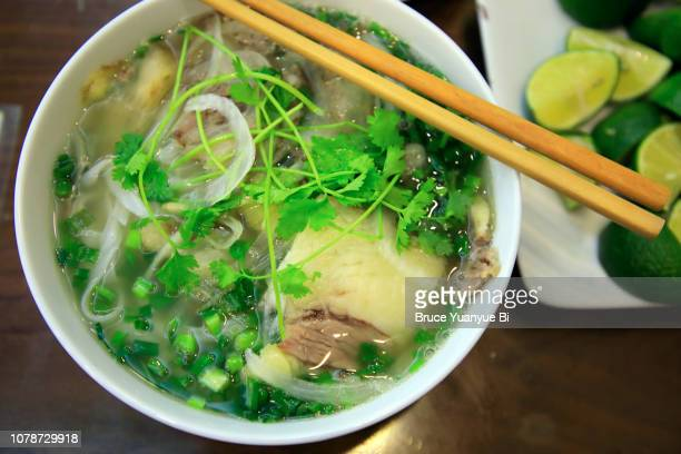 pho nam gau noodle soup - pho soup stock pictures, royalty-free photos & images