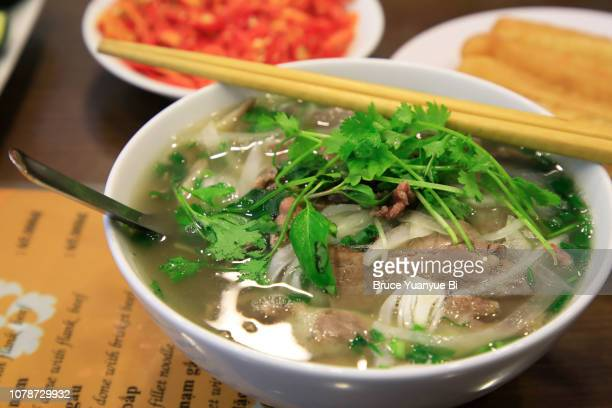 pho tai bap noodle soup - pho soup stock pictures, royalty-free photos & images