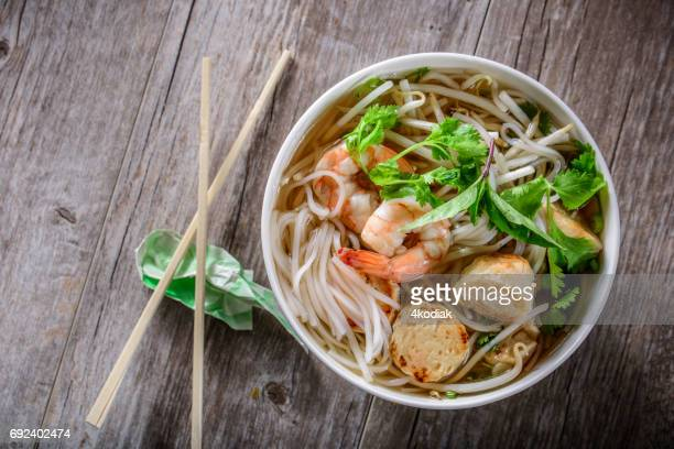 pho, vietnamese soup bowl, with seafood - traditionally vietnamese stock pictures, royalty-free photos & images