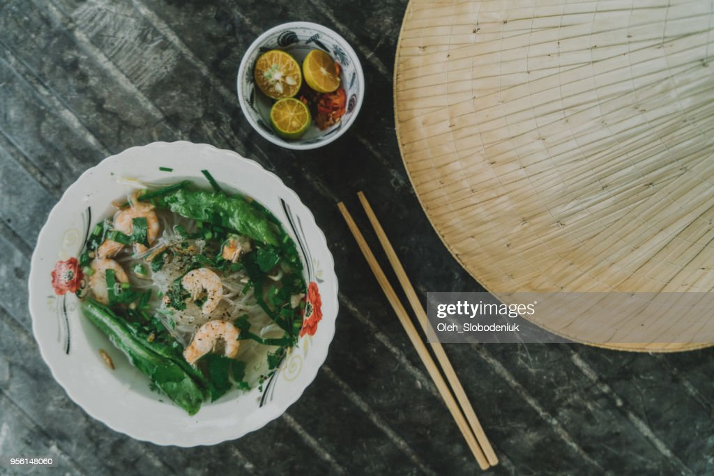 Pho with shrimp on the table near Asian conical hat : Stock Photo