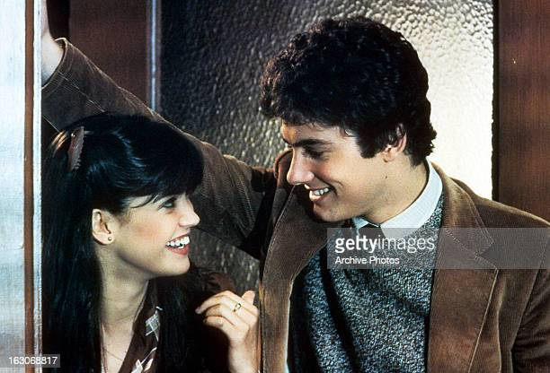 Phoebe Cates flirts with Zach Galligan in a scene from the film 'Gremlins' 1984